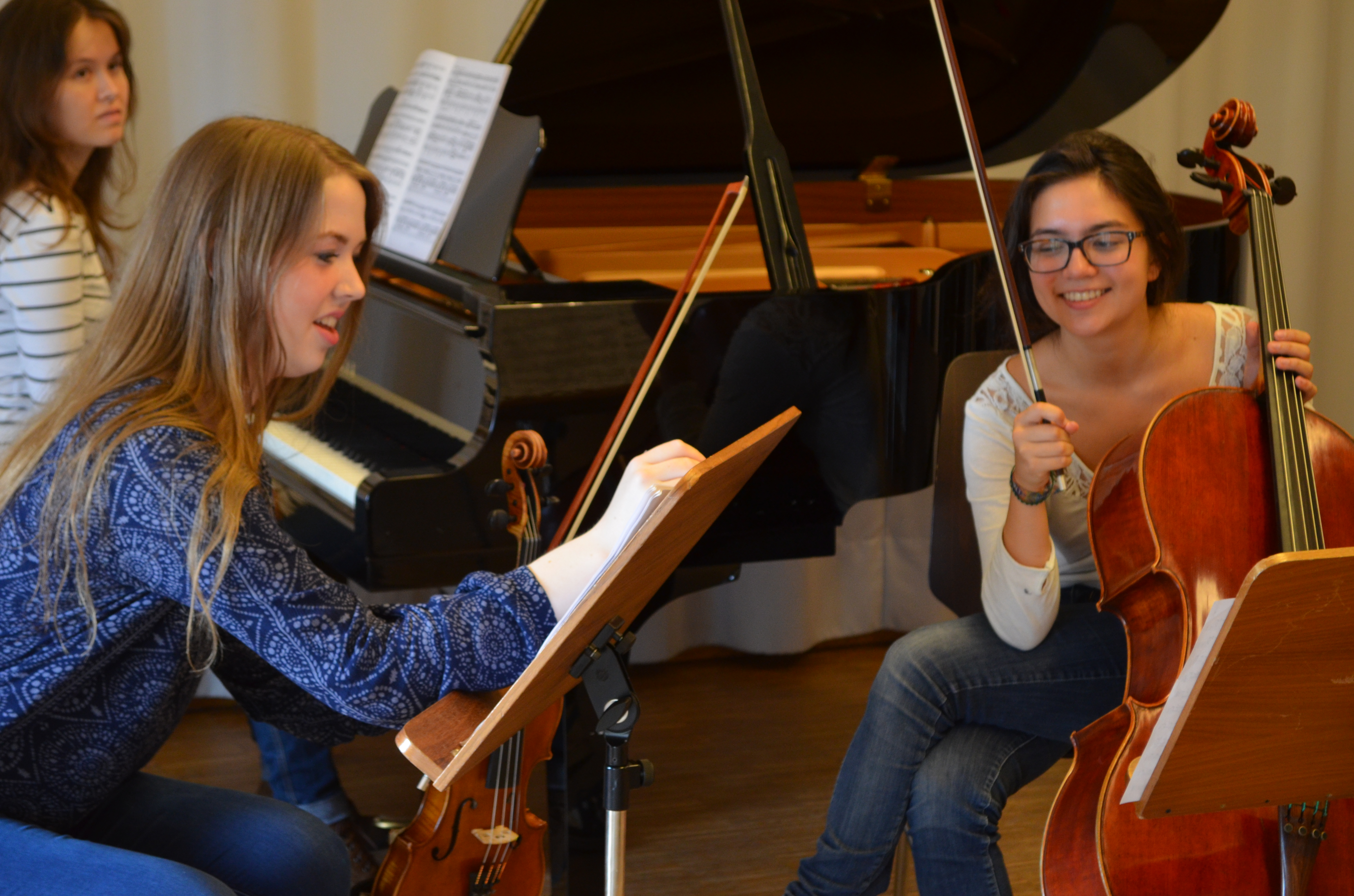 Students at a chamber music rehearsal.